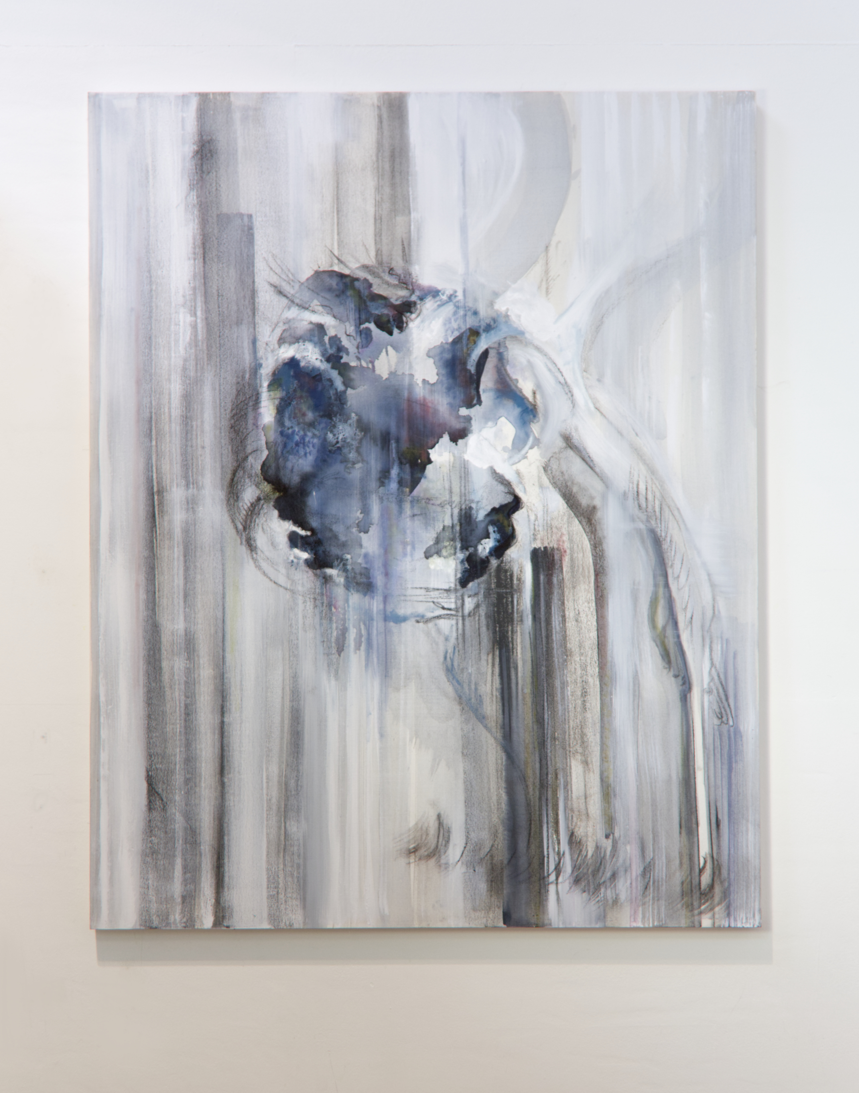 A painting mounted on a white wall. The painting is light and has dominant vertical brush strokes. In the centre is a globular form in bleeding inks and charcoal.