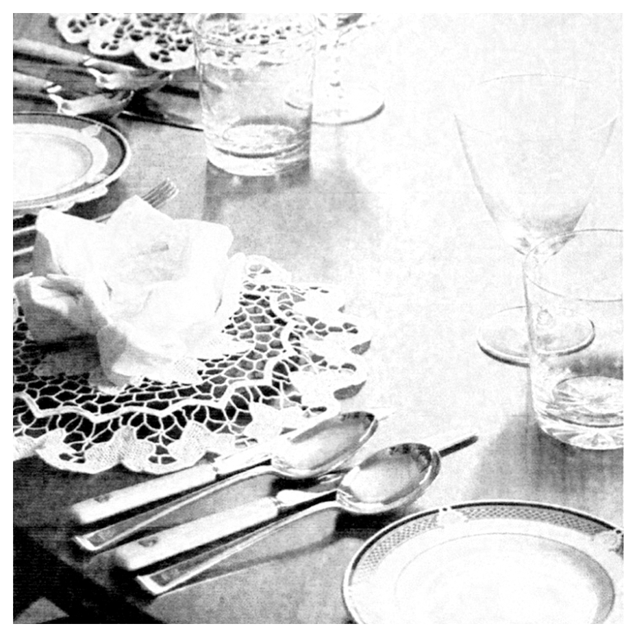 Black and white dining table set with glassware and silver cutlery