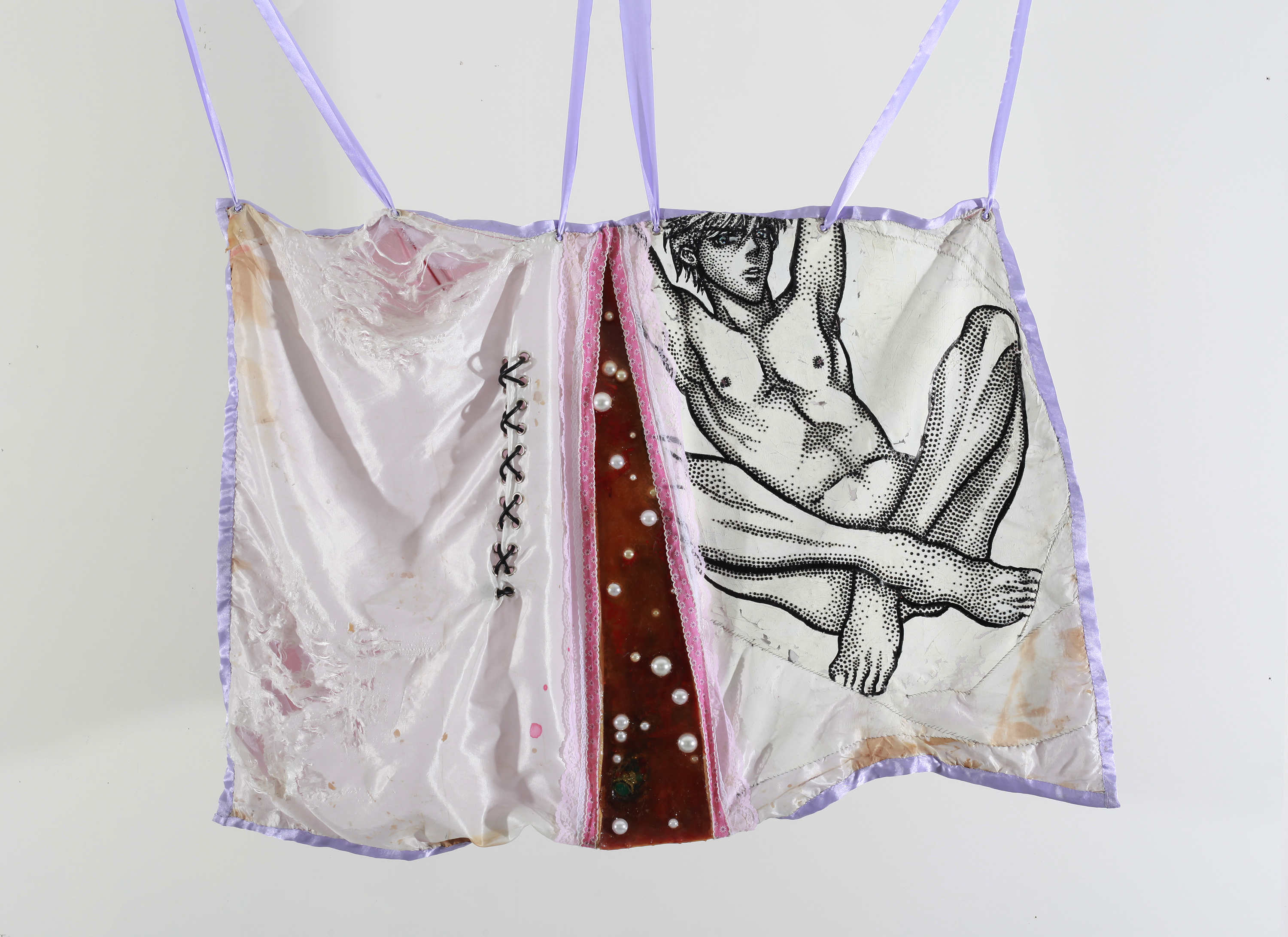 Mixed media work suspended by lilac ribbons, shows a nude male figure in black and white made of rhinestones