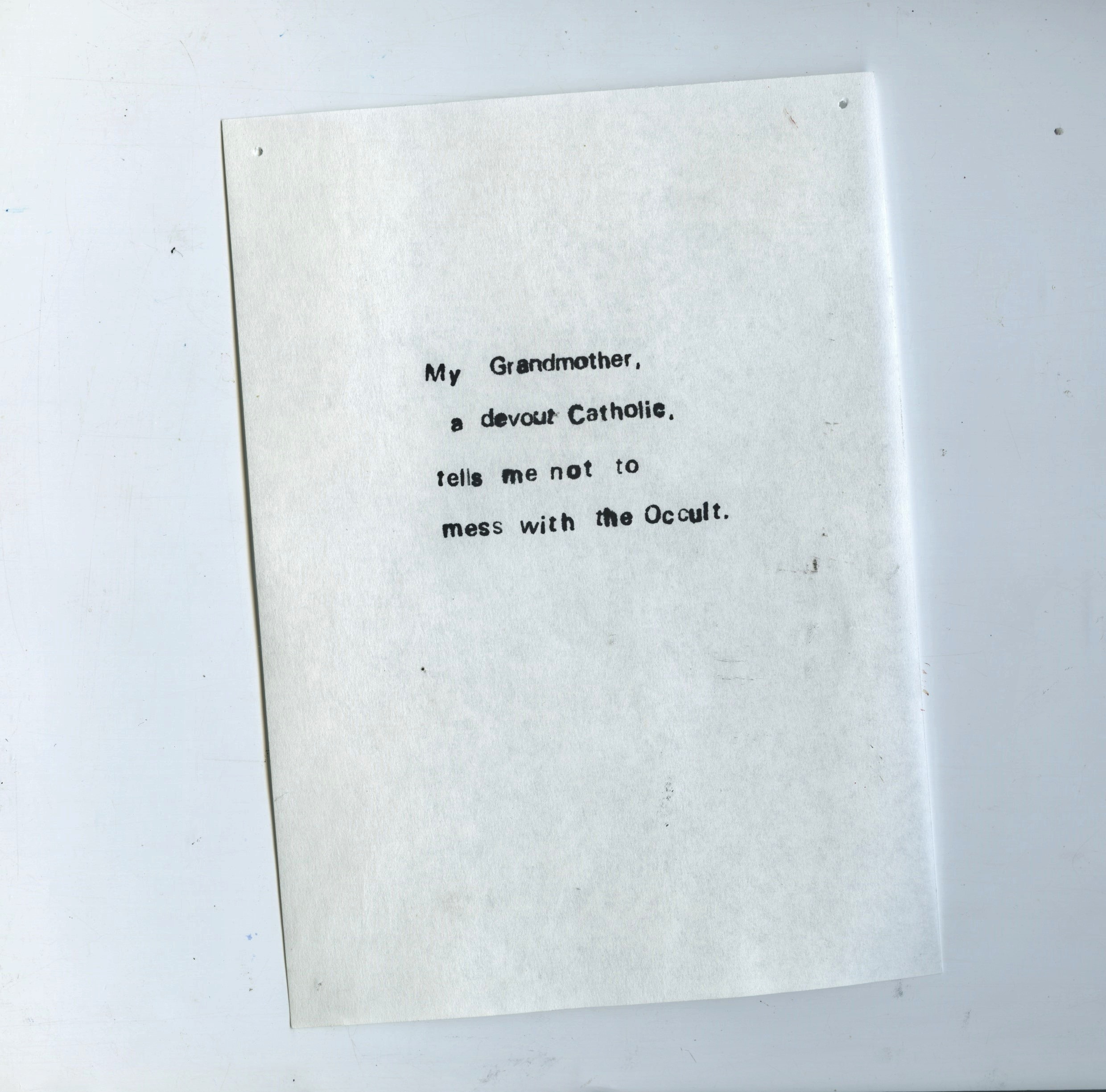 """Scanned sheet of Bible paper with text printed on it in black ink. The text reads: """"My Grandmother, a Devout Catholic, tells me not to mess with the occult""""."""