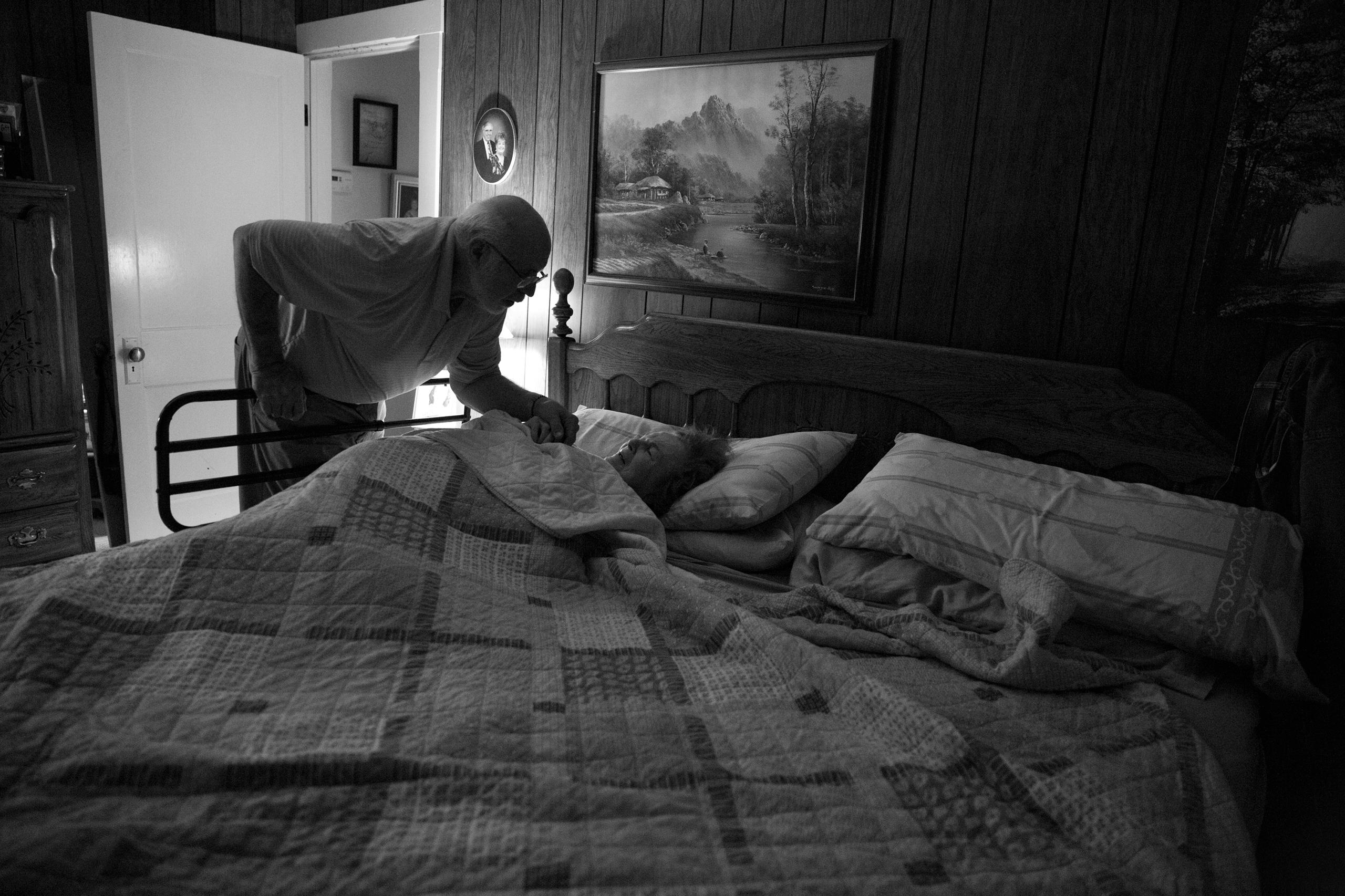 Ed comforts Karen in bed at night
