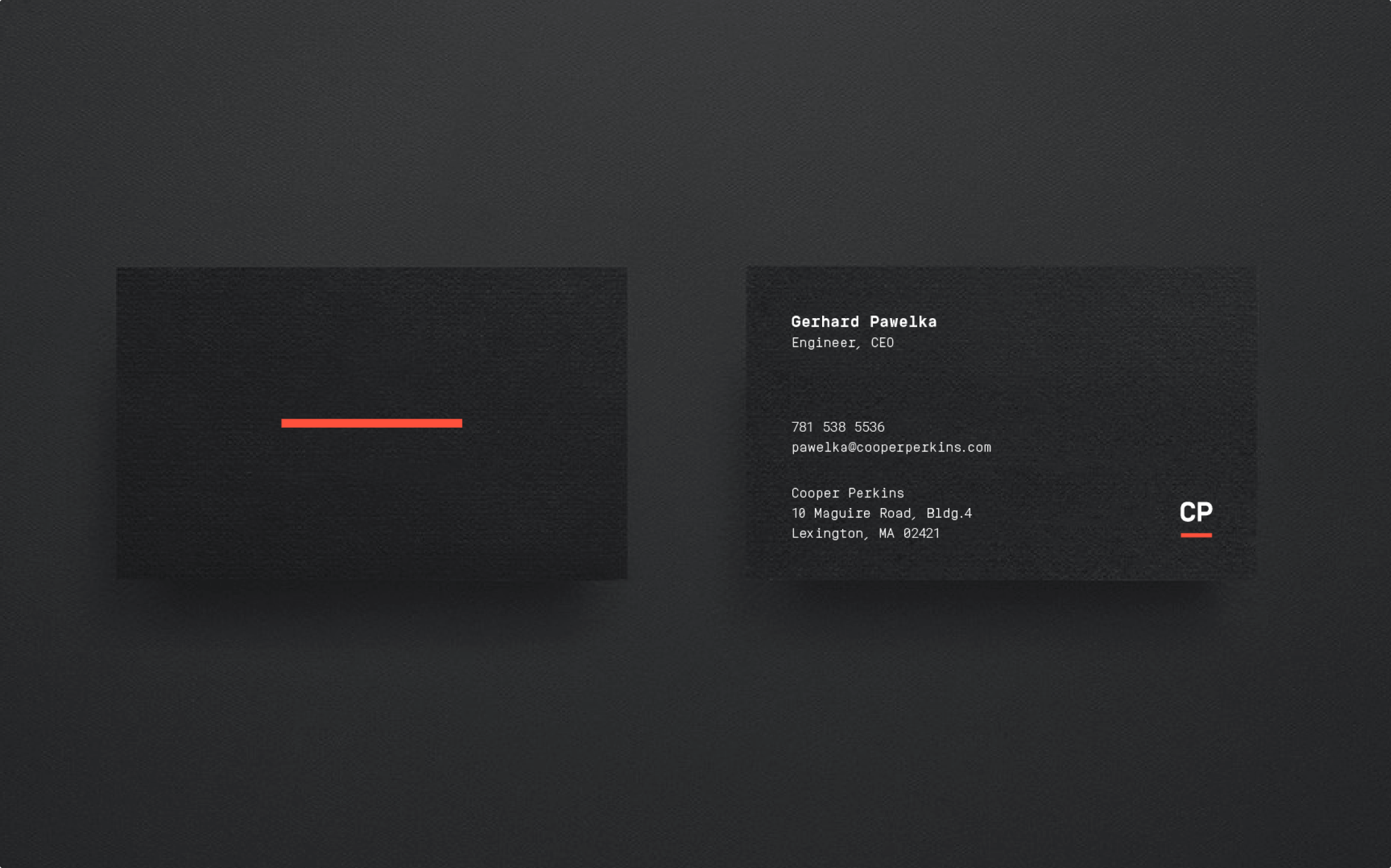 The front and back of Cooper Perkins' business cards, featuring the bold line and typewriter font.