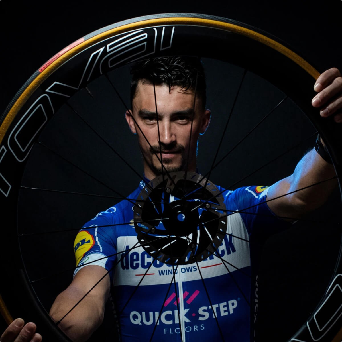 A cyclist holds a Roval wheel.