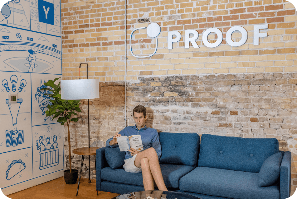 Image of someone sitting on a couch in an office