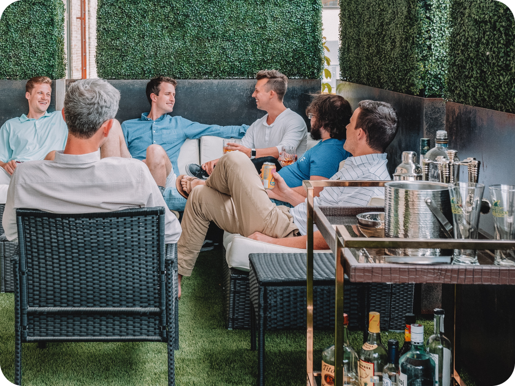 Several colleagues having drinks in an outdoor area
