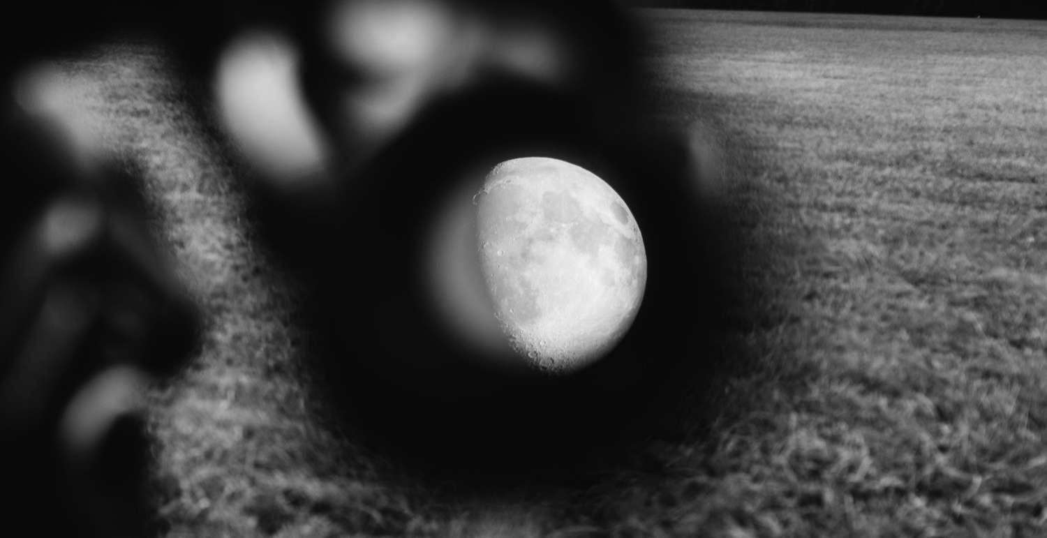 Artistic black and white photograph of the moon.