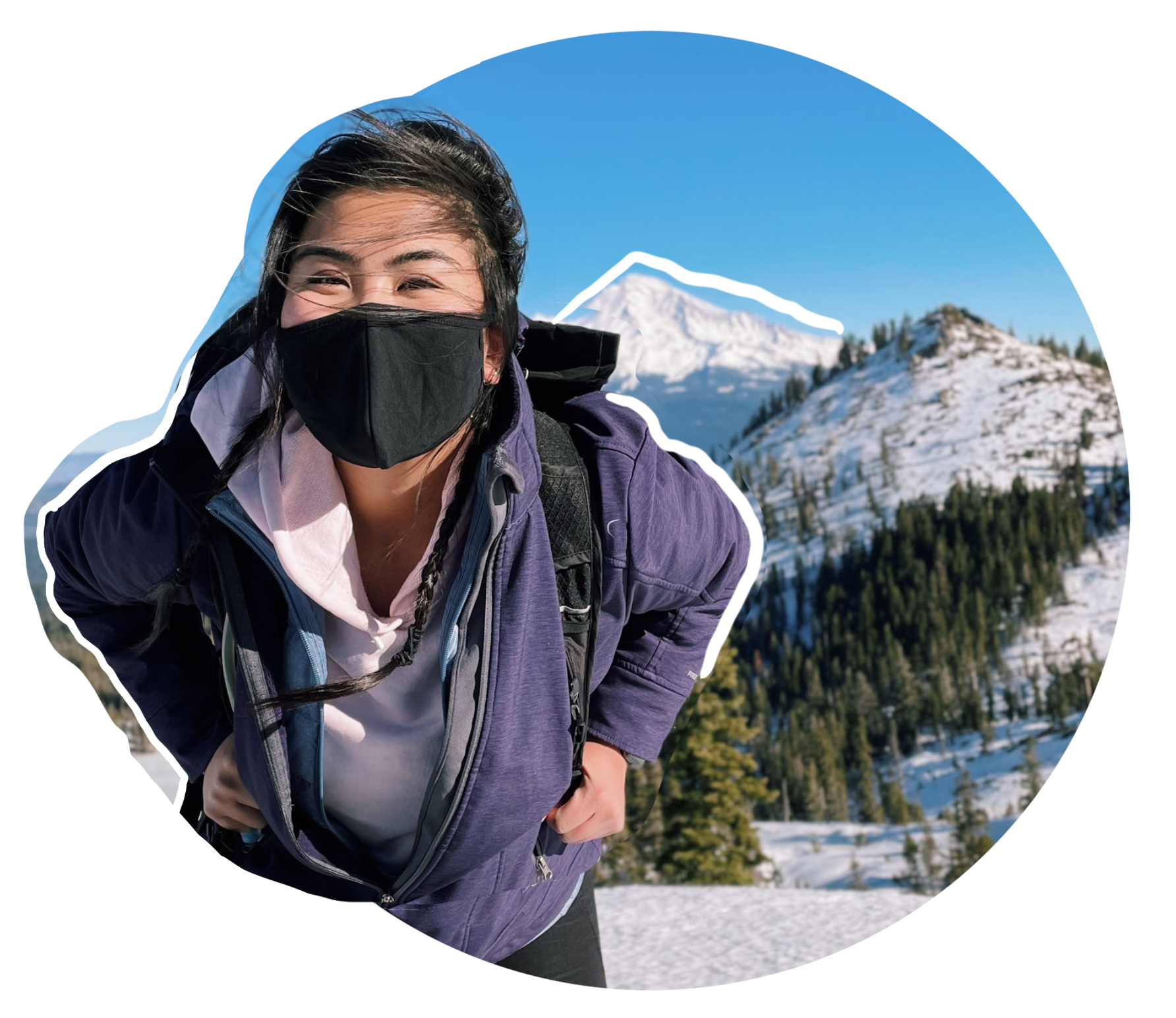 Marie wearing a mask in the mountains