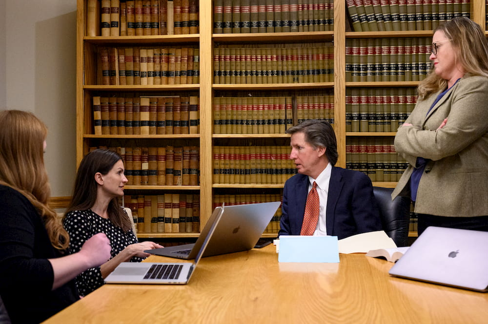 Chris Parks Law legal team meeting at a conference table