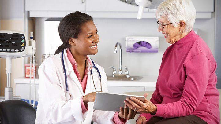 Dental Provider Helping Patient