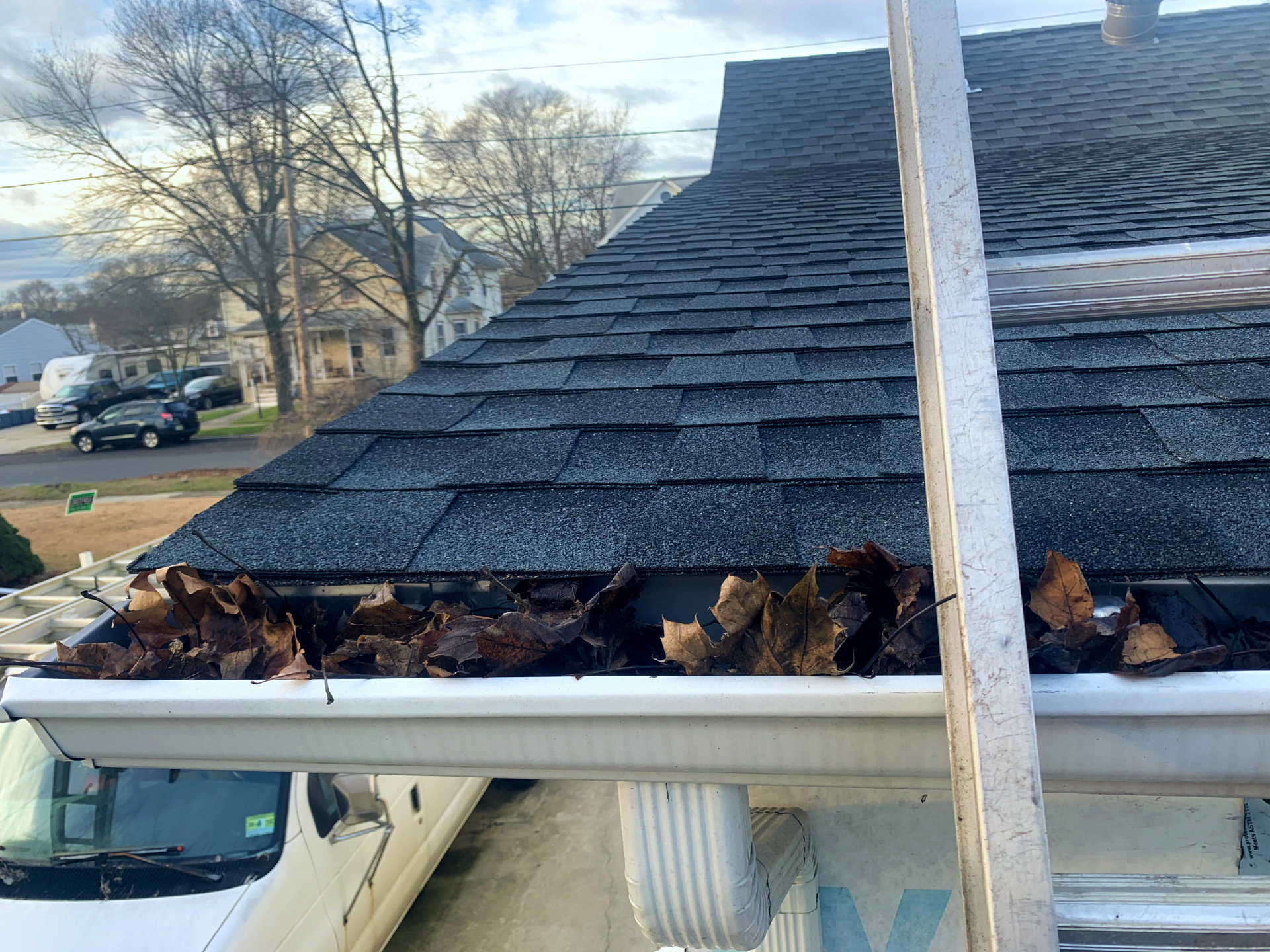Clogged Gutters Getting Cleaned