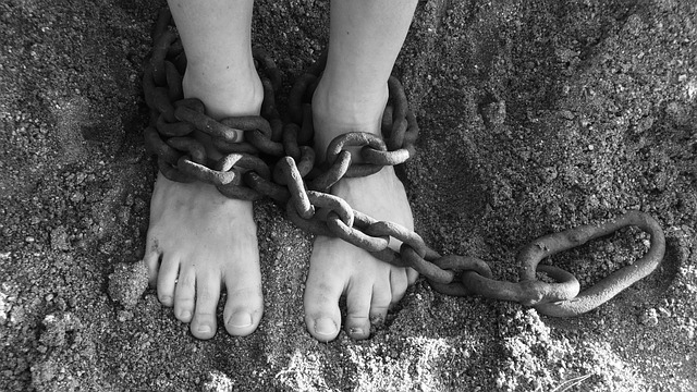 Person chained around their feet
