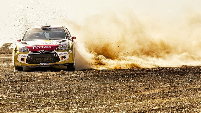 All-terrain Dirt race car skidding