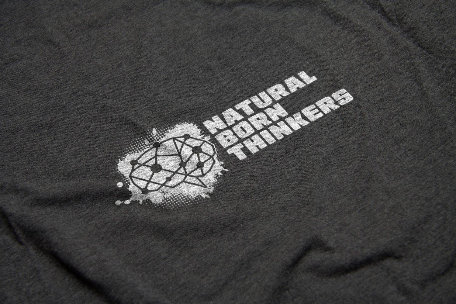 Natural Born Thinkers Logo Design by Carl Gamble on a t-shirt