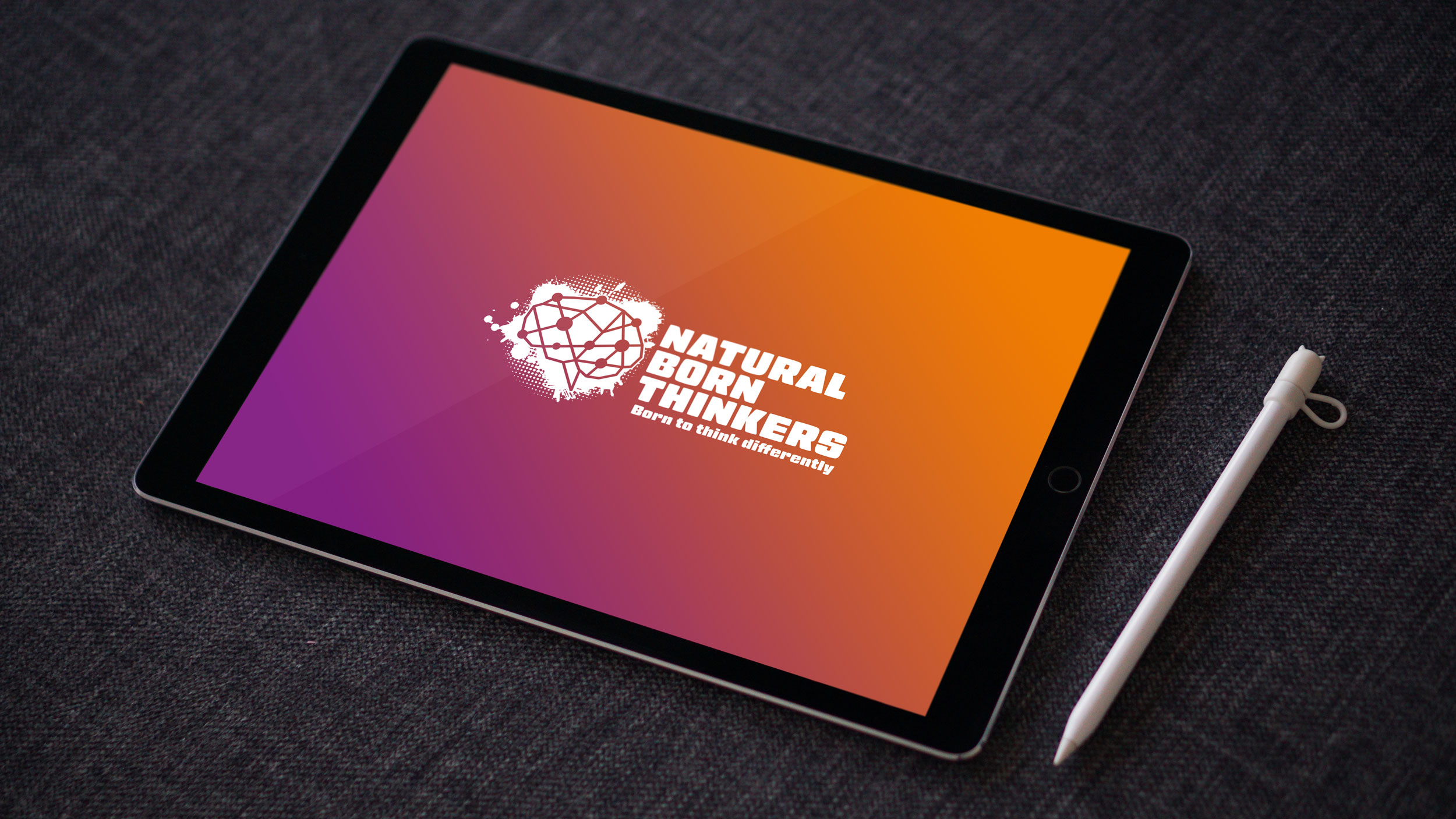 Natural born thinkers logo design on a tablet screen.