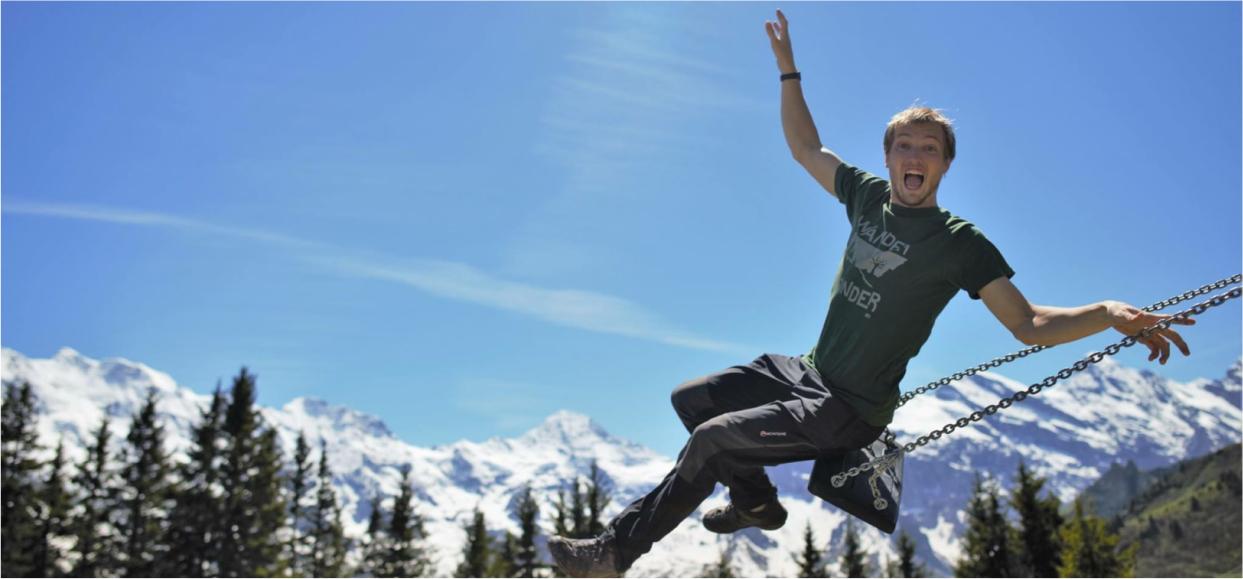 Lost Shapes Wander Wonder T-shirt on dark green worn by man in Swiss mountains