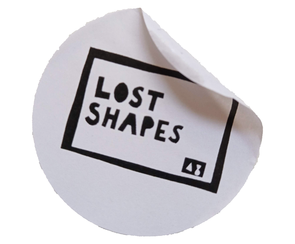 Lost Shapes sticker, black text white background