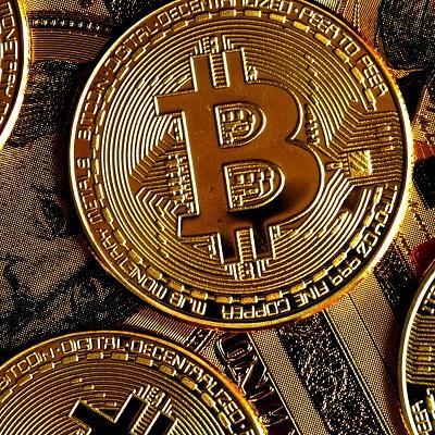 Imagem representando uma moeda com a logo do Bitcoin