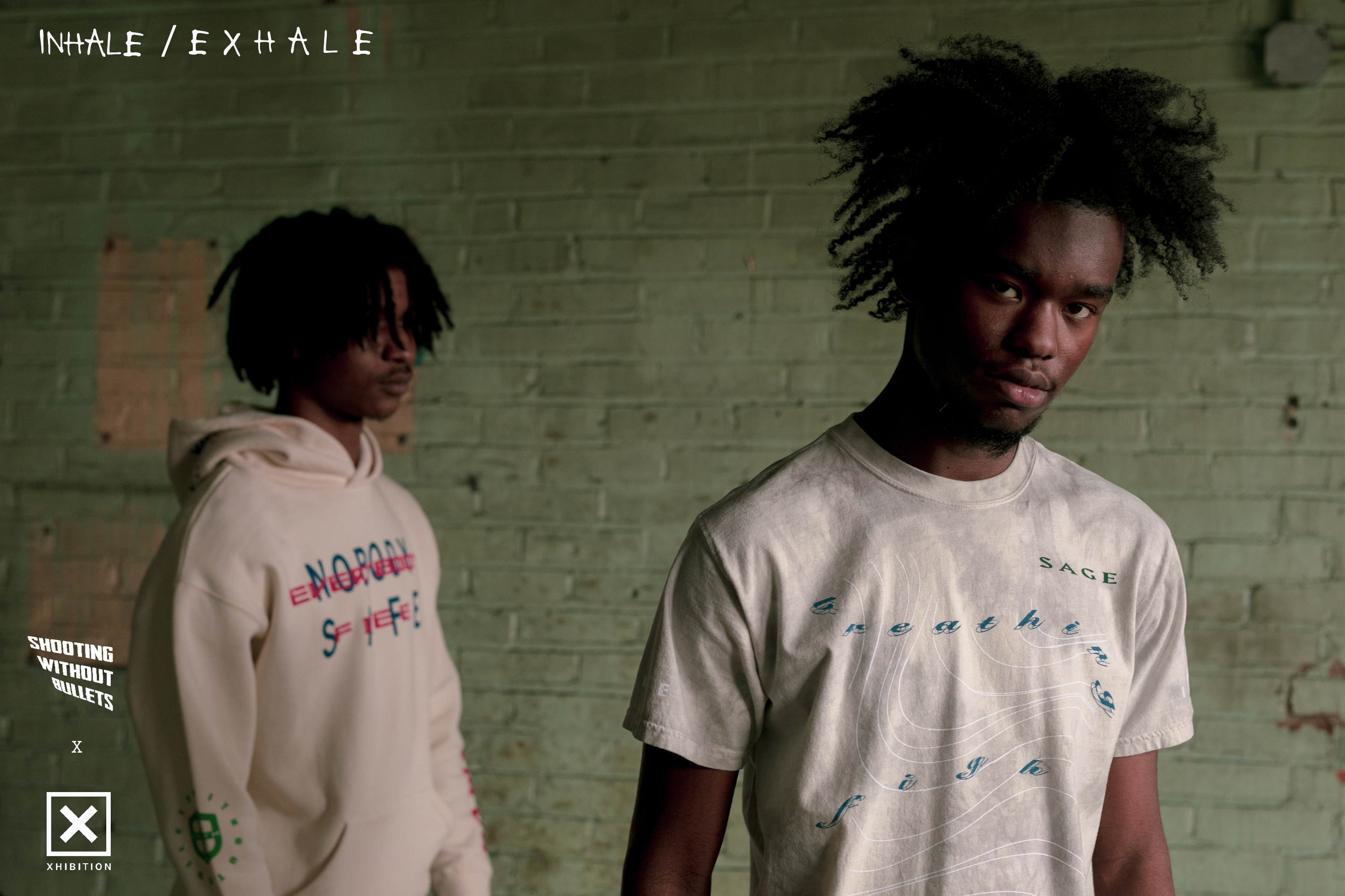 Campaign image from SWOB x Xhibition capsule collection of people wearing a hoodie and t-shirt