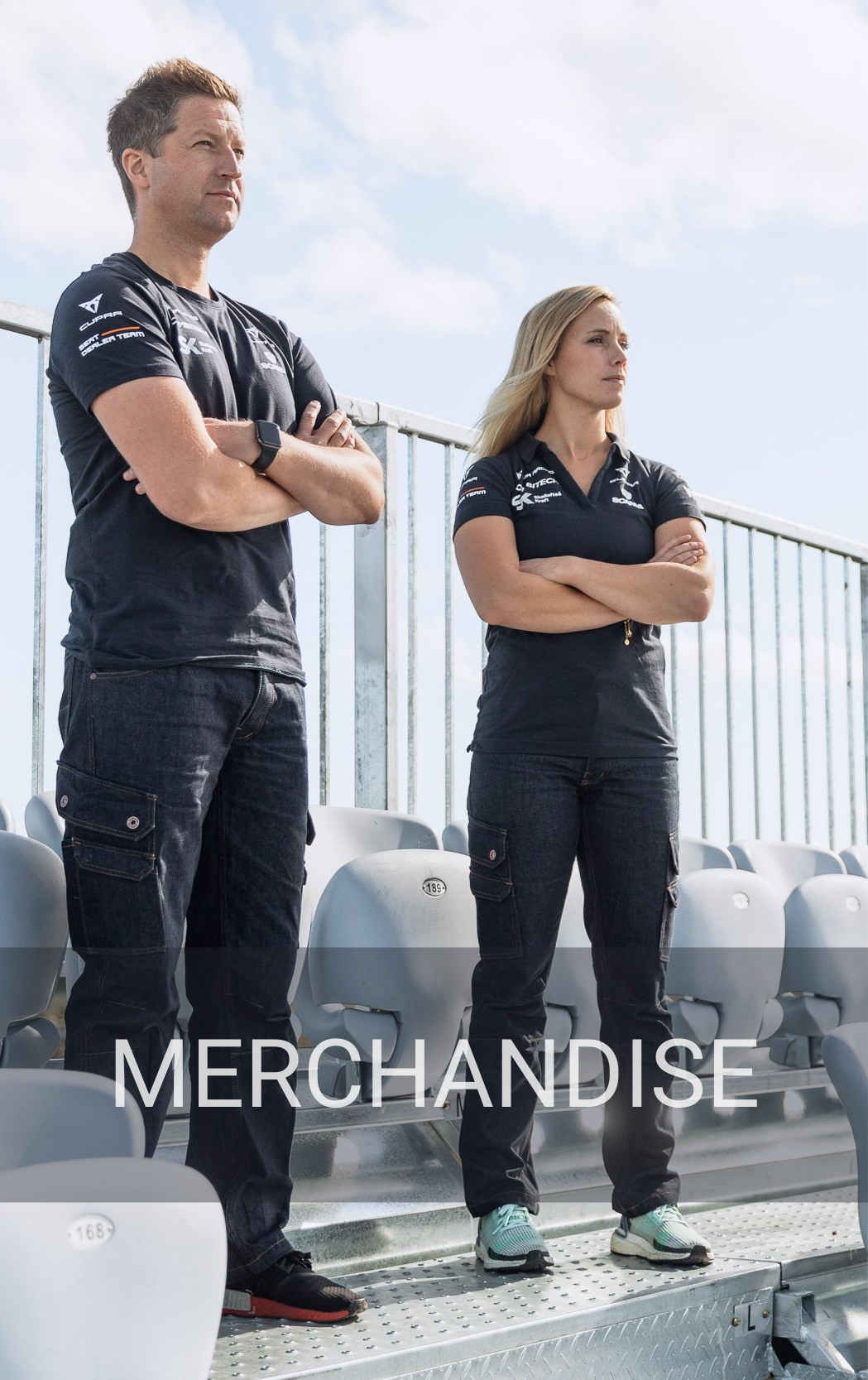 An image to showcase a service called merchandise. With two racecar drivers wearing a custom made clothing collection.