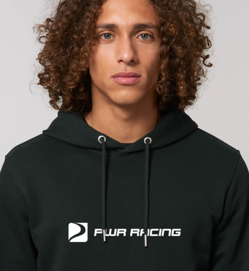 A young man with a black hoodie. The hoodie is branded with PWR Racing.
