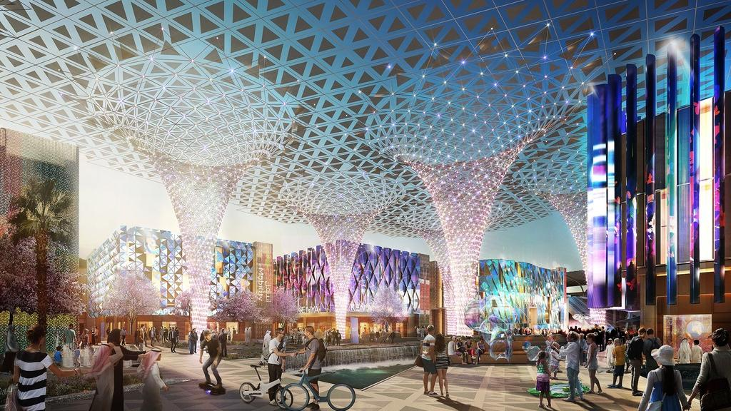 A preview of the EXPO2020 Dubai from one of the pavillions. With people on bicycles and futuristic theme.