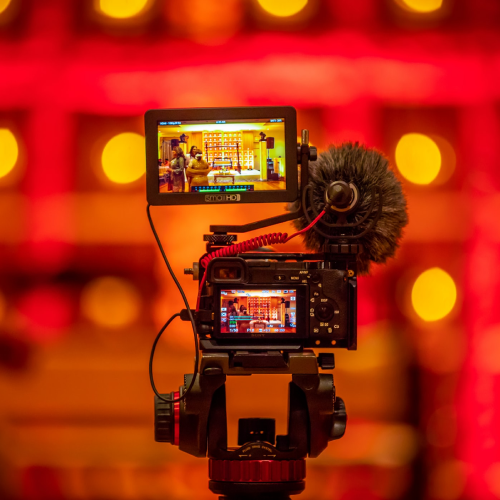 A digital camera in a red colored room