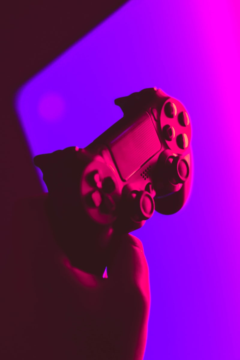 a ps4 handcontroller in a pink room