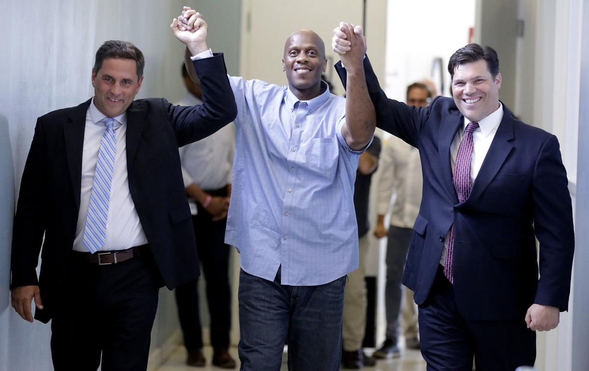 From left to right: Eric Cullen, Corey Atchison, and Joe Norwood on the day of Atchison's exoneration and release from prison