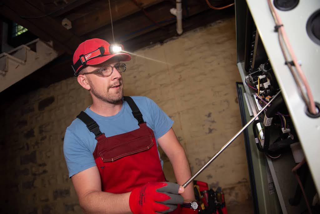 Jonathan inspecting a furnace