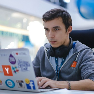 A picture of me coding on a laptop at a hackathon