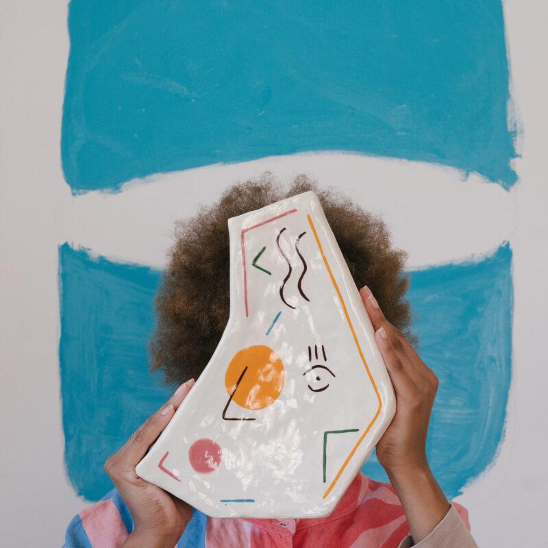 Person holding an art piece