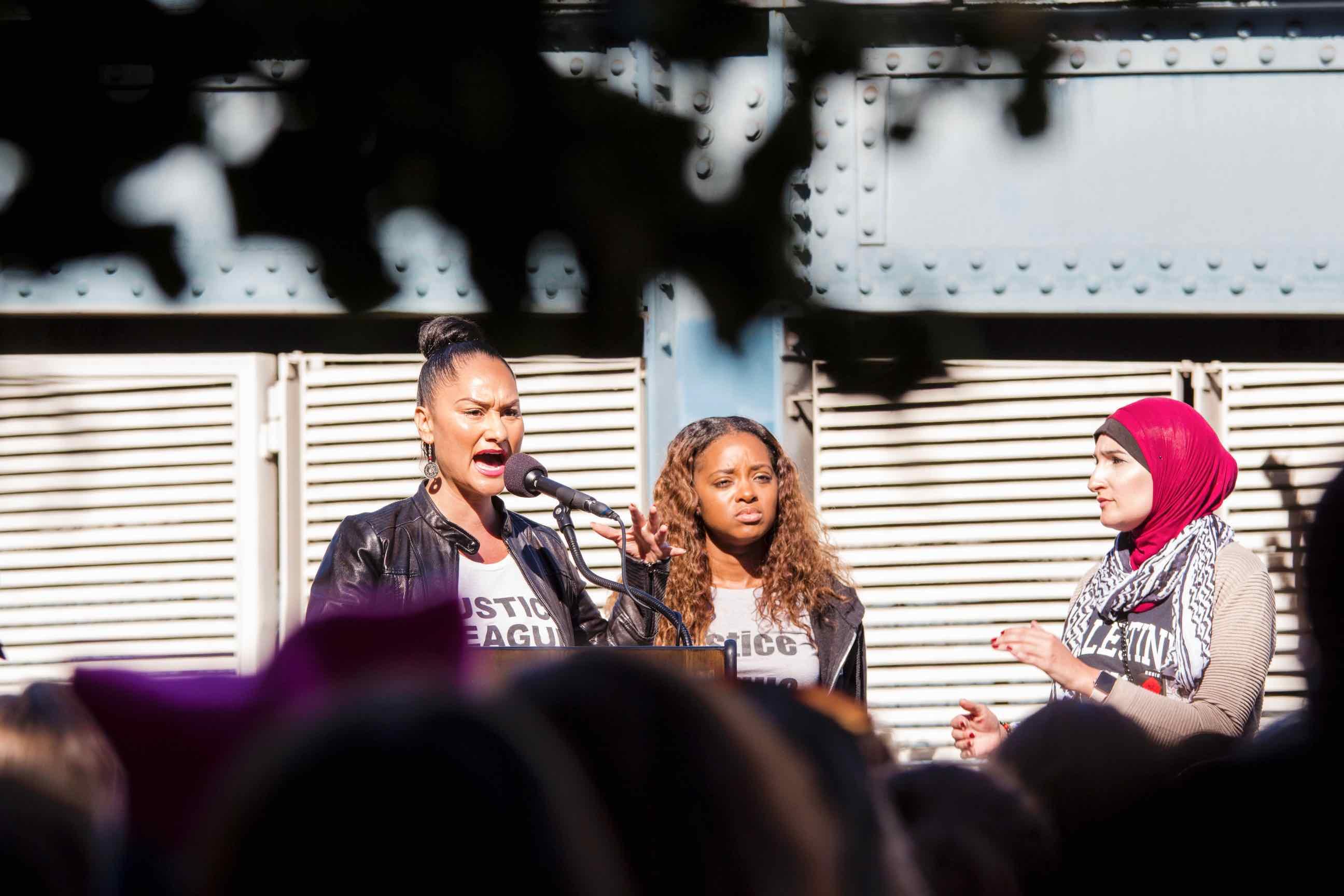 women speaking at a podium