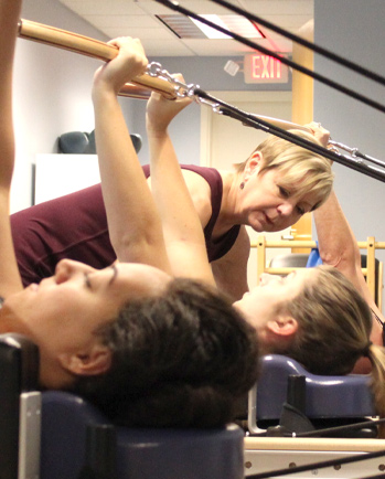 Barb Constant Instructing a Group Class at Constant Movement in Grand Rapids, MI