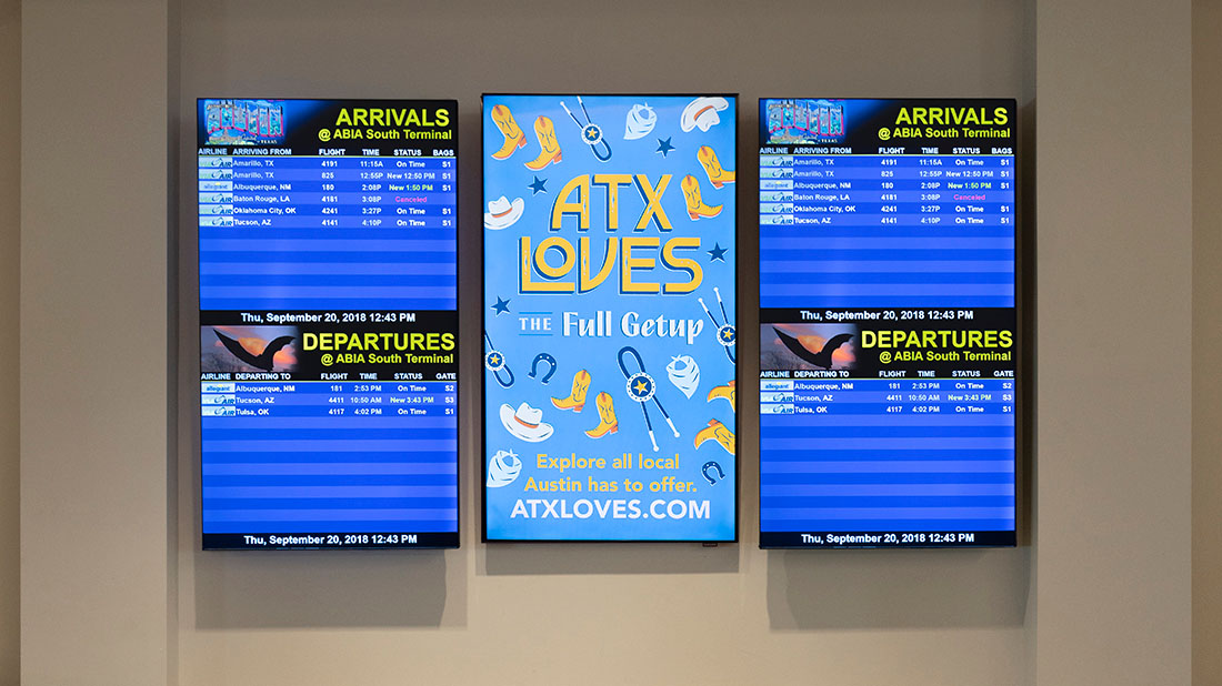 An ATXLoves sign at the airport that reads ATXLoves: The Full Getup. Explore all local Austin has to offer.