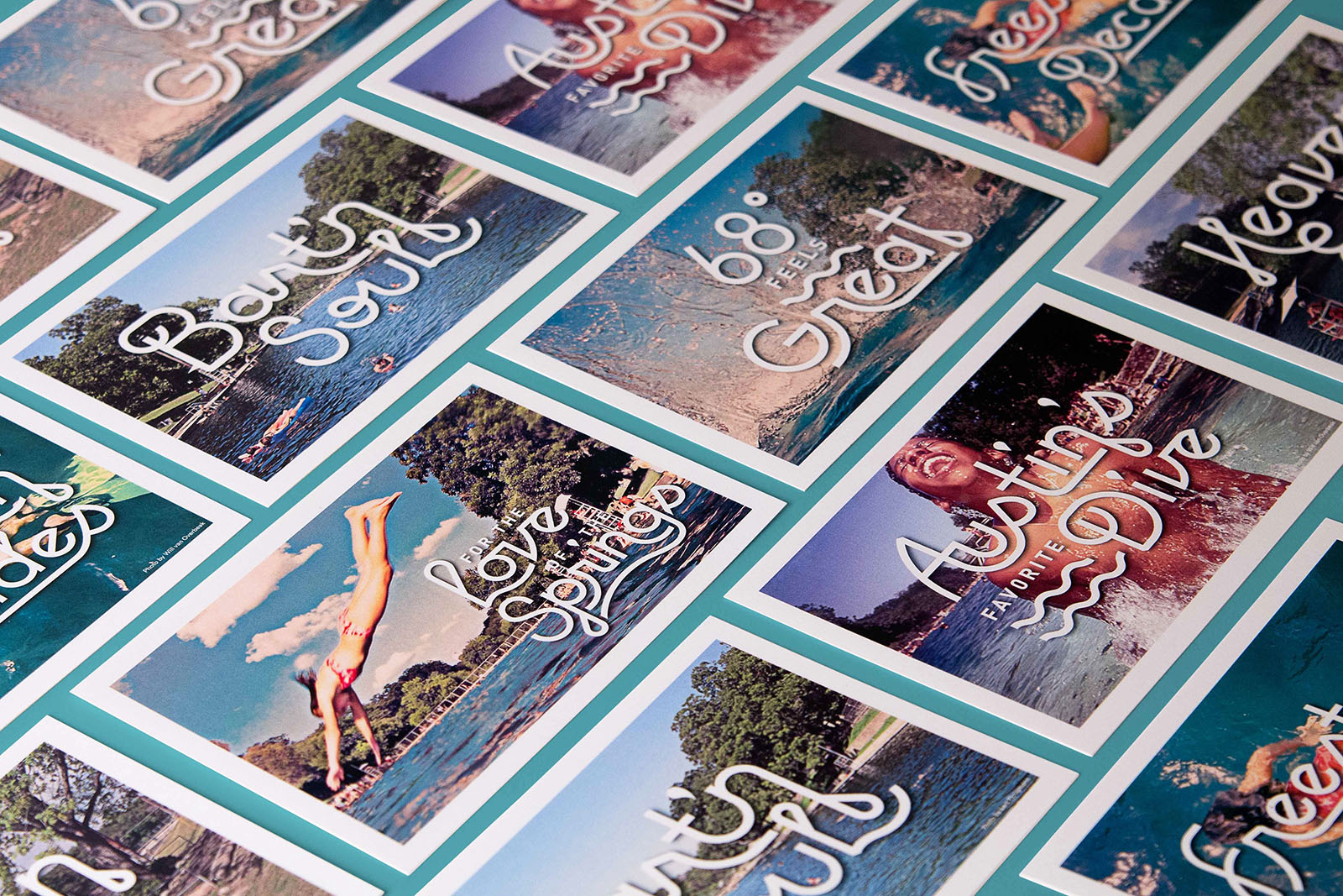 """A collection of Barton Springs Conservancy postcards with slogans like """"68 degrees feels great"""" and """"Austin's favorite dive."""""""