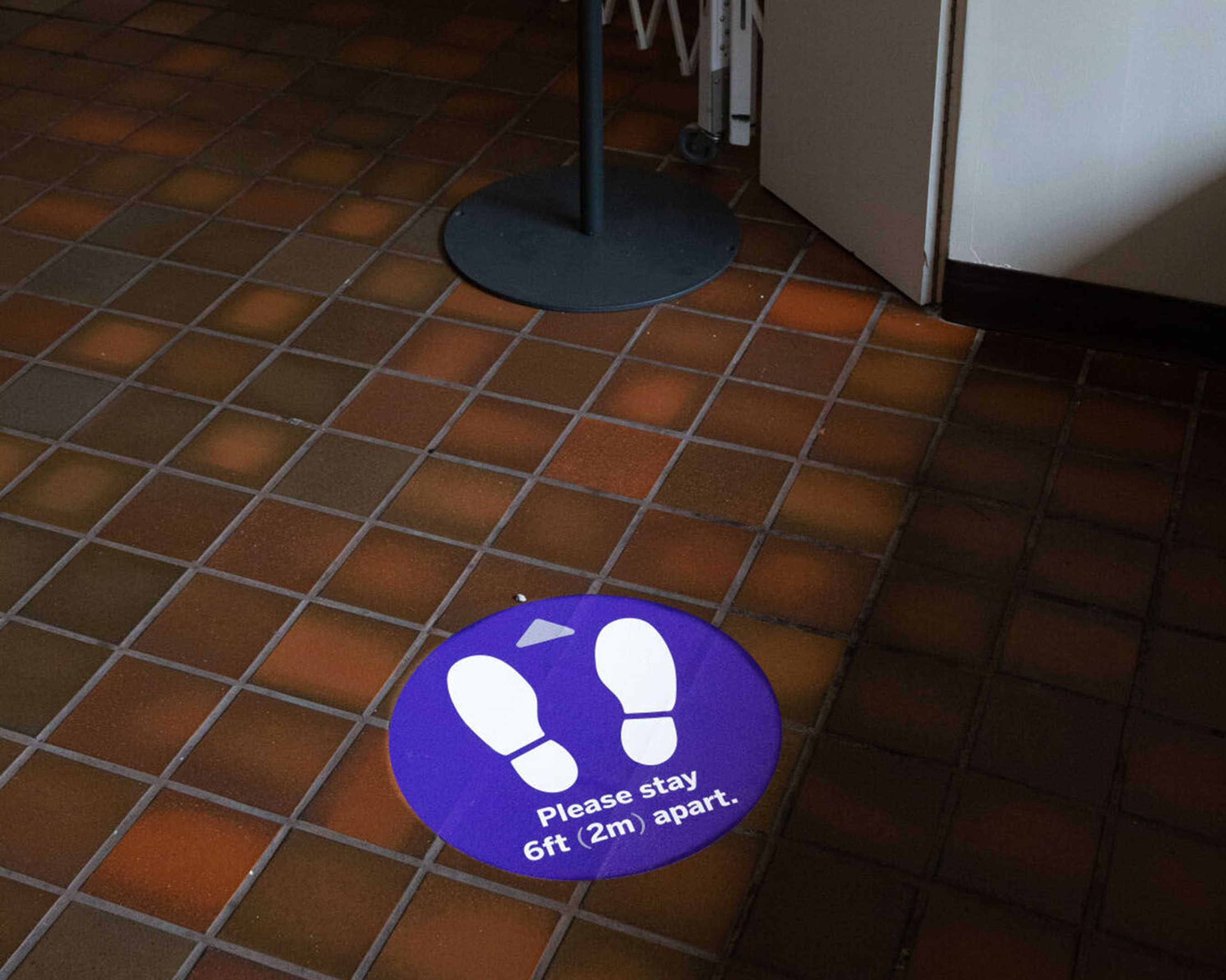 A social distancing sticker on the UCC floor.