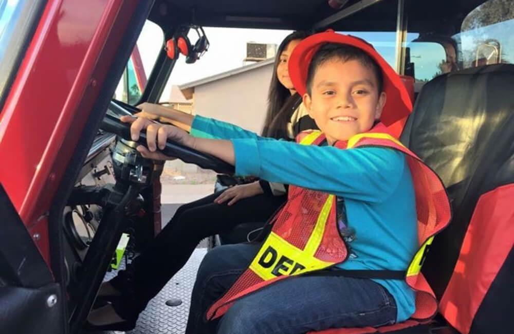 Kid riding truck.