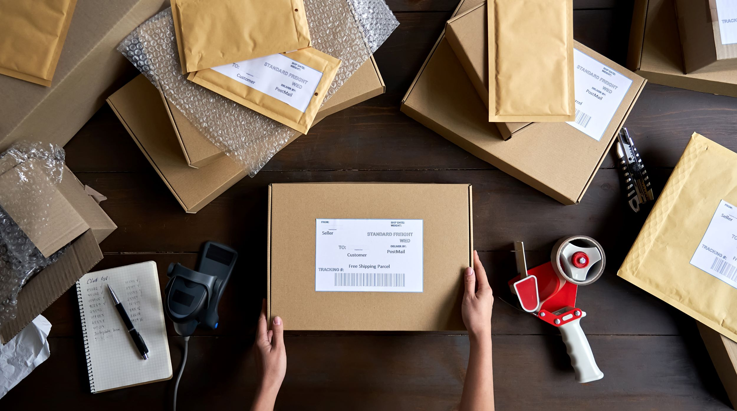An ecommerce business owner prepares orders for shipping