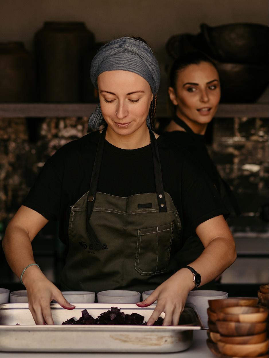 greek cuisine women cooking in a restaurant in mykonos chef noema