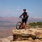 Profile image of a man on a bike at a cliffside.
