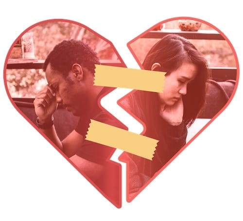An unhappy Black man and Asian woman sit with their backs to each other within a broken heart with band-aids on it.