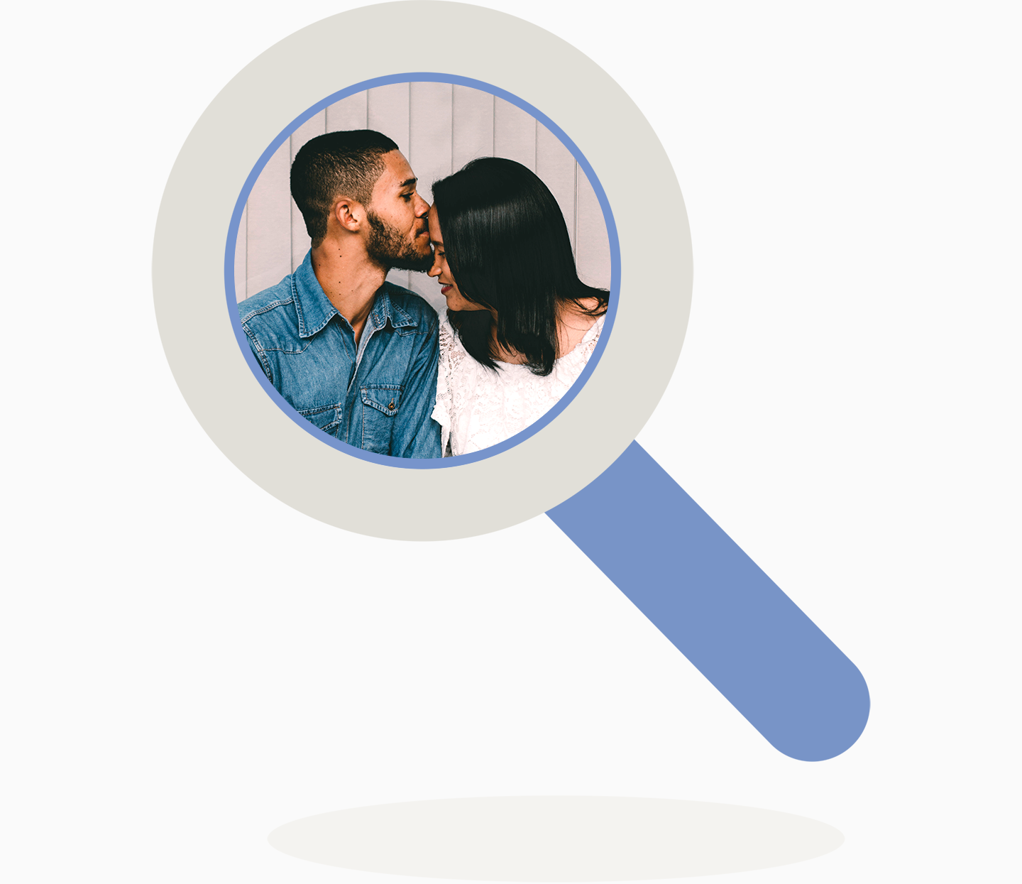 Magnifying glass reveals a man kissing a woman on the forehead.