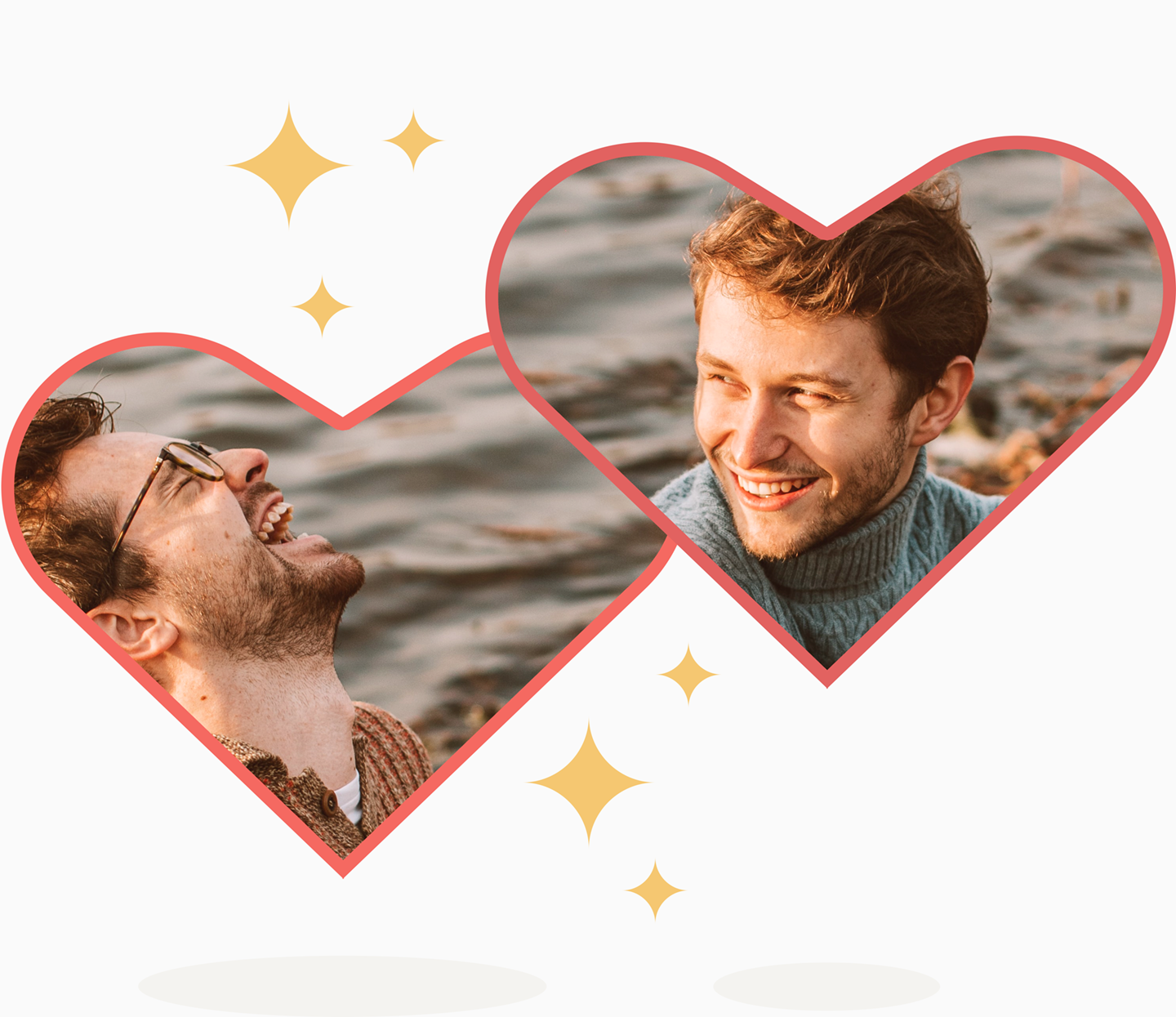 Two white men in two hearts laugh with each other by the water.