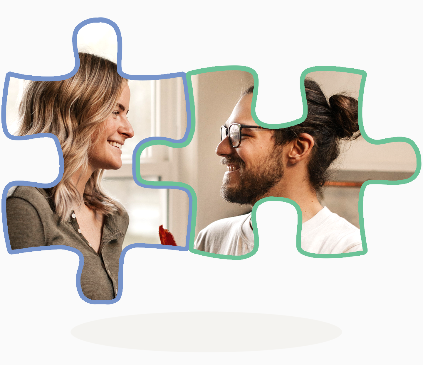 Puzzle pieces fit together to form a happy couple looking at each other.