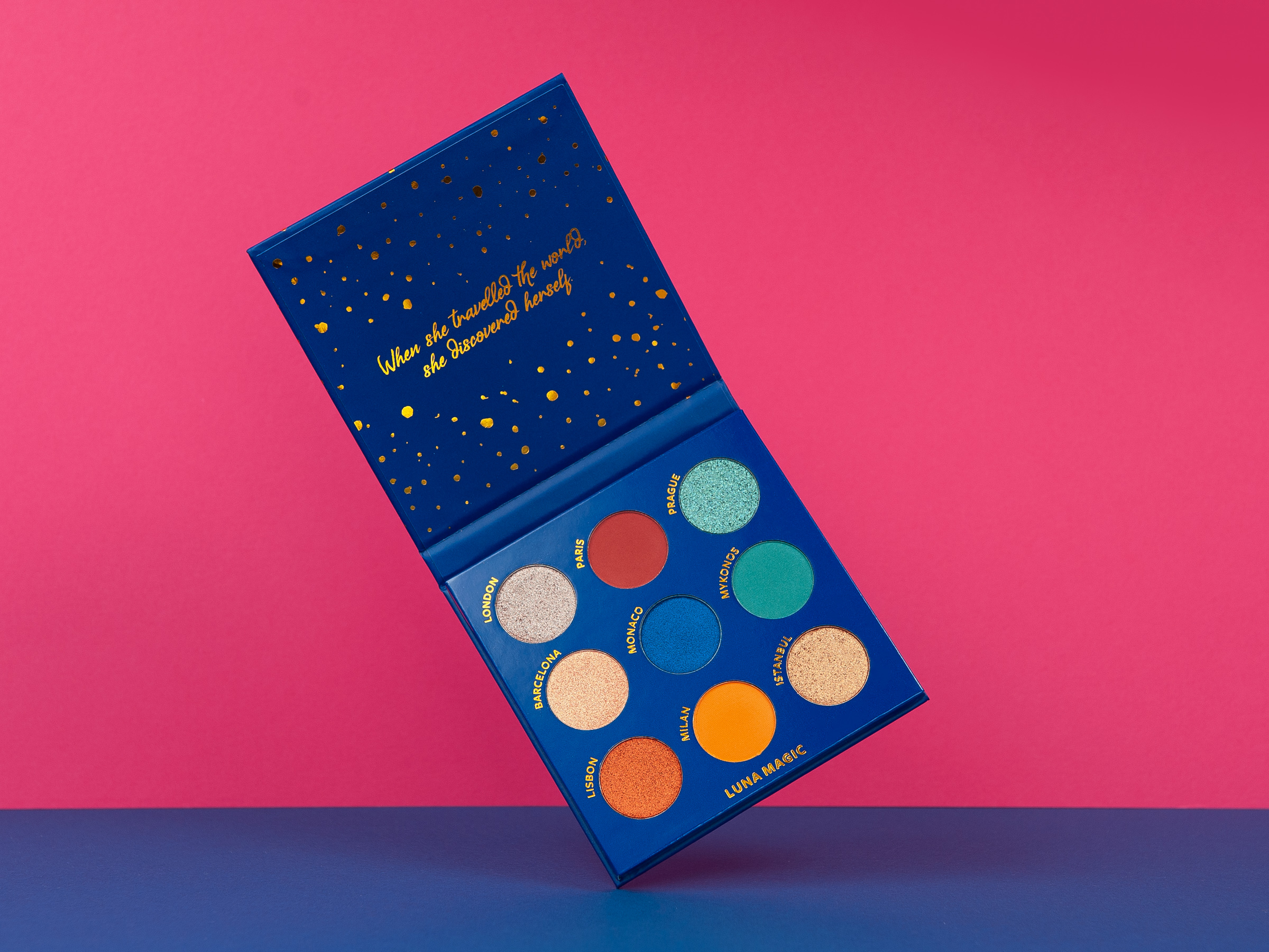 A Luna Magic Cosmopolitan eyeshadow palette on a pink background