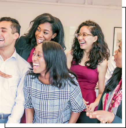 A diverse group of young adults, looking out of frame and laughing.