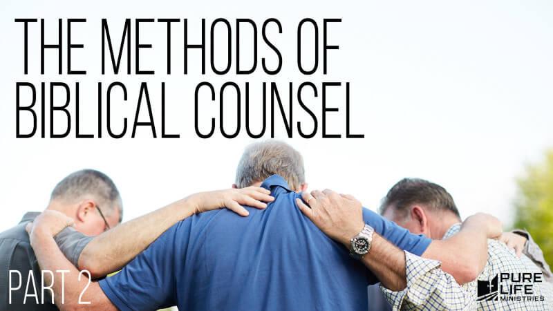 Men standing together in prayer