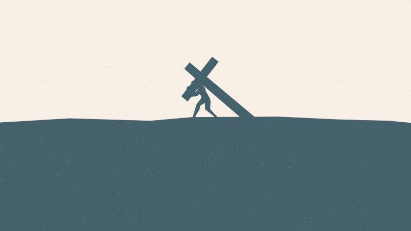 Man carrying a cross
