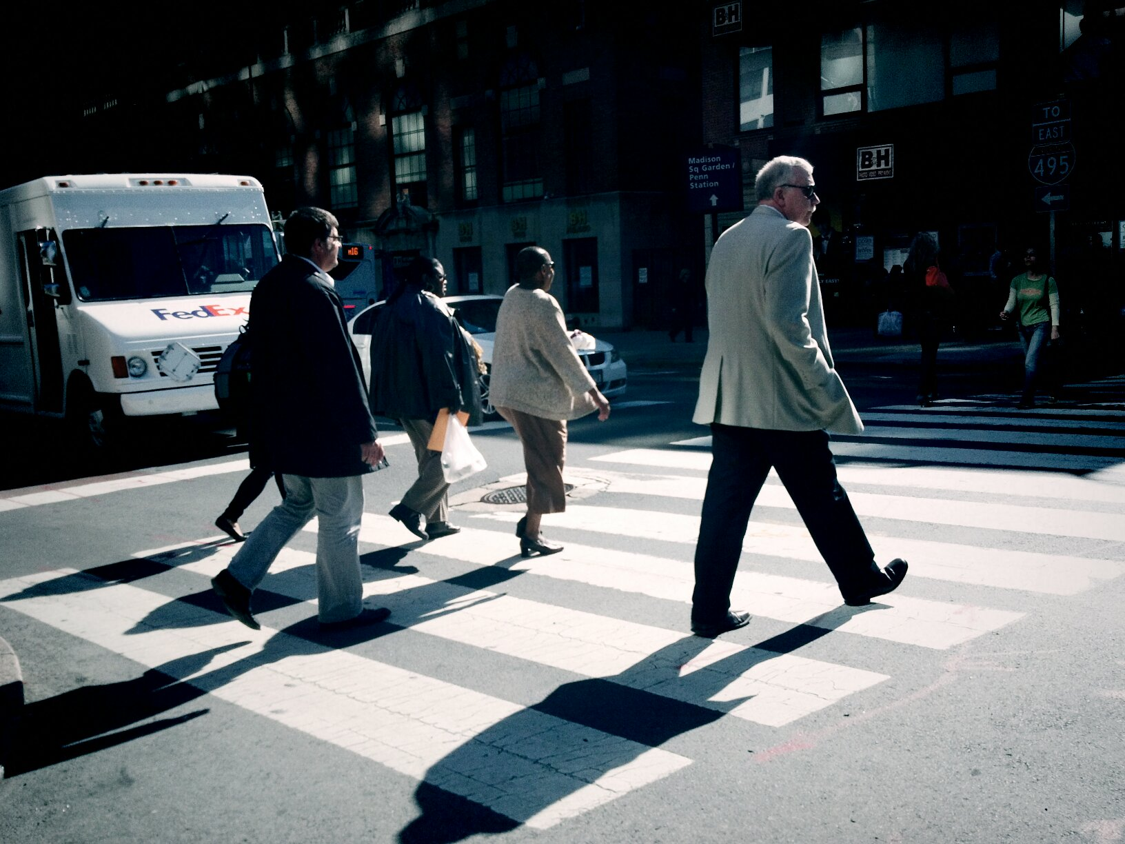 everyday people crossing at intersection in NYC