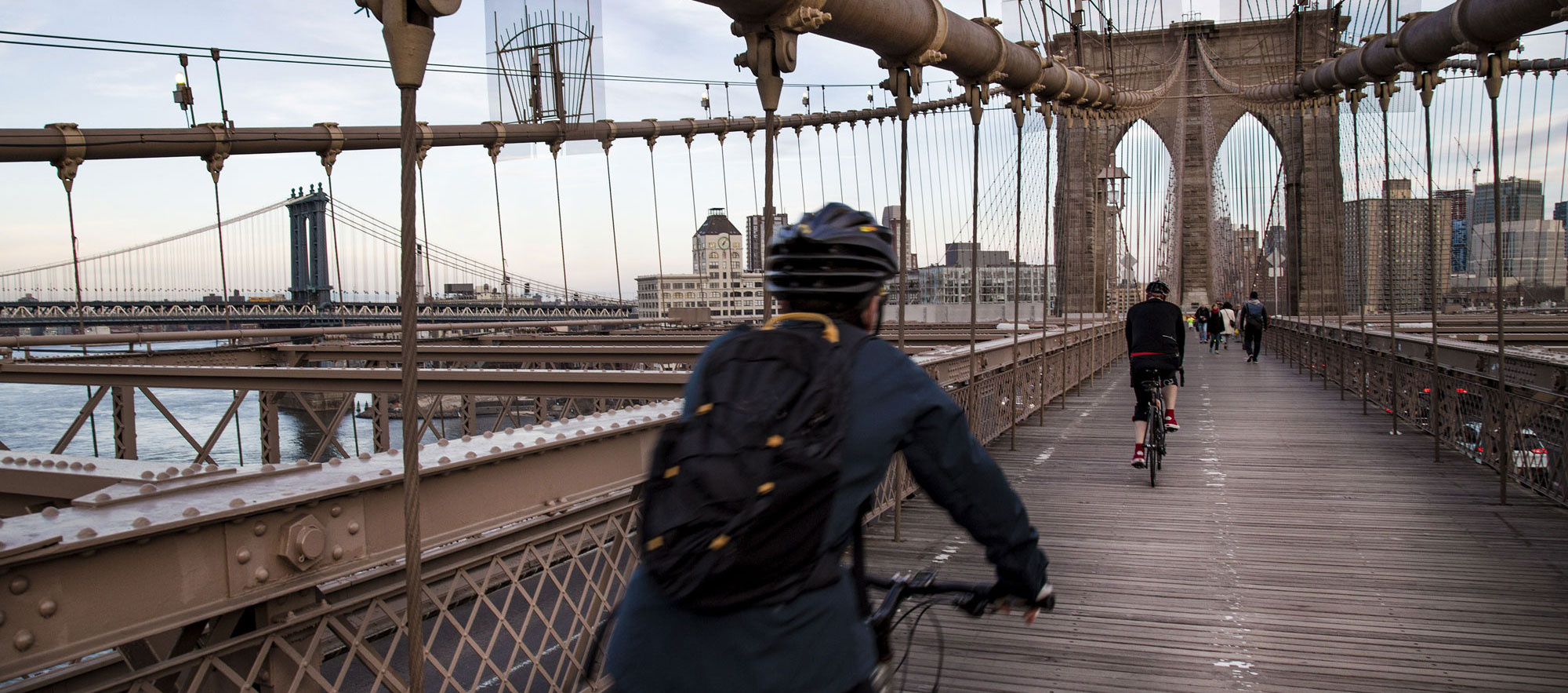 Pedestrians and bicyclist crossing Brooklyn bridge